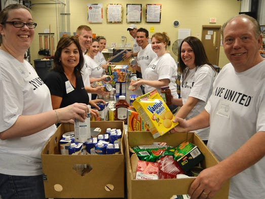 We have 100+ volunteers giving time to The Food Bank today! Here's Regions Bank working hard & having fun - inspecting, sorting & packing food donations! #SgfDayofCaring
