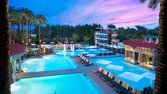 Nighttime views of the sprawling pool area at Hyatt Regency Scottsdale Resort & Spa.