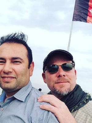 This undated photo provided by NPR shows Zabihullah Tamanna, left, and David Gilkey. Gilkey, a veteran news photographer and video editor for National Public Radio, and Tamanna, an Afghan translator, were killed while on assignment in southern Afghanistan on Sunday, June 5, 2016, a network spokeswoman said. (Monika Evstatieva/NPR via AP)