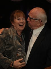 Diane Raver, co-founder of the Garden State Film Festival, presents Ed Asner with the Lifetime Achievement Award during the 2012 Garden State Film Festival gala award ceremony at the Crystal Point Yacht Club in Point Pleasant.