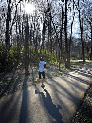 A woman runs on the Springfield Greenway, which is in the planning stage for a new extension. The greenway, built in phases by the city over about 15 years, has influenced how the community uses the parks and even how it thinks about fundraisers.