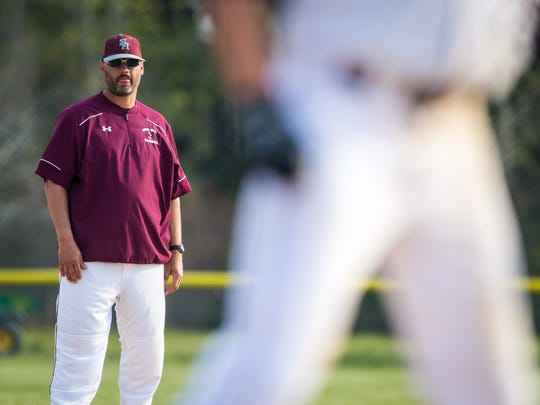 Snow Hill head coach Todd Lampman watches a batter from the distance.