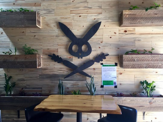 The DeLuxe's rabbit logo adorns one wall of the restaurant's new West Street Market digs.