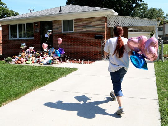 Tonya Ryan, 39 of Allen Park brings balloons and candles