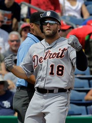 Detroit Tigers outfielder Tyler Collins reacts after