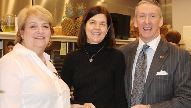 Circle of Hope Co-Chairs Steve and Kris Mullin discuss food options with Besty Eichert of the Urban Grill.