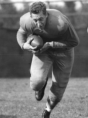 Dubuque native and Iowa running back Hank Vollenweider barrels ahead during a 1939 practice with the Hawkeyes. At the time he owned the record for longest kickoff return for touchdown in Hawkeyes history, a 92-yarder against South Dakota.