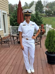 Regine Tugade poses in her Naval Academy uniform. Tugade will start her college track career Jan. 7.