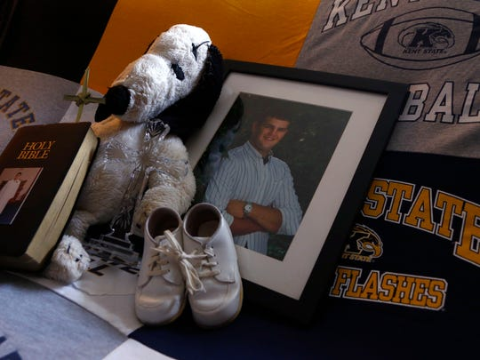 Mementos from Mike Willis' life fill the living room of Jim and Betsy Willis' home in Ontario. Mike Willis passed away in 2011 from a heroin overdose. Brian J. Smith / News Journal