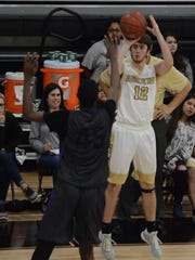 Abilene High's Brian Patton shoots a 3-pointer over