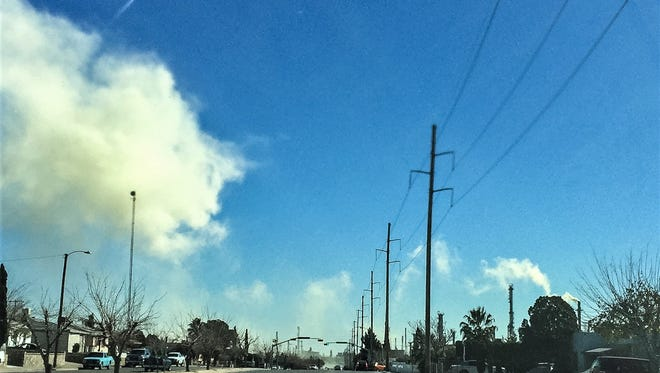 Smoke from Western Refining is shown blanketing Trowbridge Drive near the facility Jan. 11. Initially, a large yellow cloud that could be seen for miles rose from the refinery, but it dissipated.