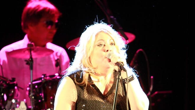 Pamela McNeill of the Fabulous Armadillos performs last New Year's Eve at the River's Edge Convention Center.