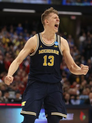Michigan Wolverines forward Moritz Wagner celebrates during the second half of U-M's 73-69 win over Louisville on Sunday, March 19 at Bankers Life Fieldhouse in Indianapolis in the second round of the 2017 NCAA tournament.