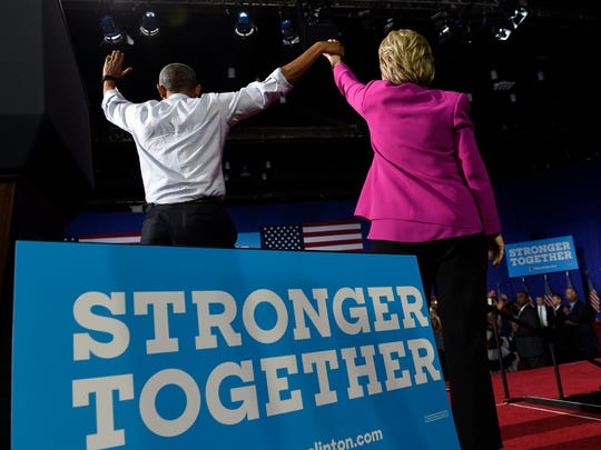 President Obama and Hillary Clinton wave following a campaign event at the Charlotte Convention Center in Charlotte, N.C., on July 5, 2016.