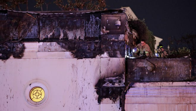Firefighters inspect fire damage at the Bellagio hotel and casino along the Las Vegas Strip.