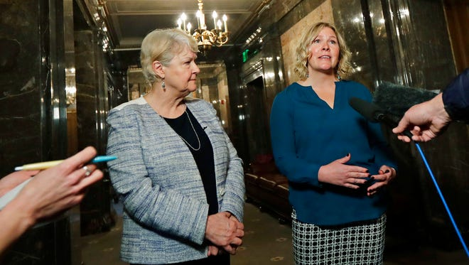 In this March 21, 2018, photo, Rebecca Johnson, right, a lobbyist who helped organize a letter signed by more than 200 women calling for a culture change at the Washington state Capitol, talks to reporters as Sen. Karen Keiser, D-Des Moines, left, looks on in Olympia, Wash. Washington's legislative session is over but the conversation about sexual harassment at the state Capitol continues, with the House and Senate each convening their own groups to discuss potentials codes of conduct and how to address complaints. (AP Photo/Ted S. Warren)