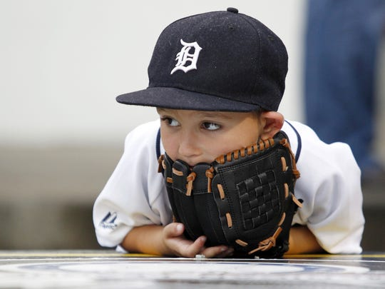 Detroit Tigers fan Santino Sargent, age 5, looks on as the Tigers warm up before playing the Pittsburgh Pirates at PNC Park.