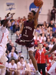 Don Bosco's Chris Paul (1) drives to the basket in