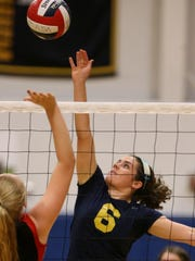 Hitter Carrie Stewart is a fourth-year varsity player for Victor.