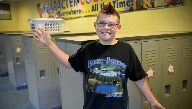 Avid Harley-Davidson motorcycle fan and Pleasantview Elementary School fifth-grader Brian Ayer, 11, wears a Harley shirt to school on Tuesday, May 31, 2016, something he's done every single school day this year. He owns 17 of the shirts and can't wait until he's old enough to own one of the motorcycles, something his family already does.