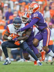Clemson cornerback Mark Fields (2) and safety Van Smith (23) tackle Syracuse wide receiver Amba Etta-Tawo (7) during the third quarter on Saturday at Memorial Stadium in Clemson.