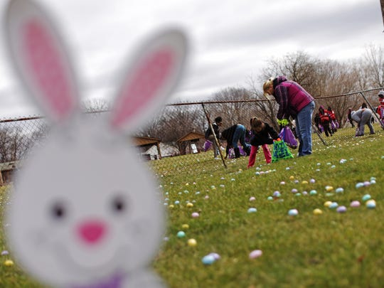 Children take part in an easter egg hunt on Friday, March 25, 2016, put on by the Community Impact Church at the Fraternal Order of Police Lodge 126 in Flint.