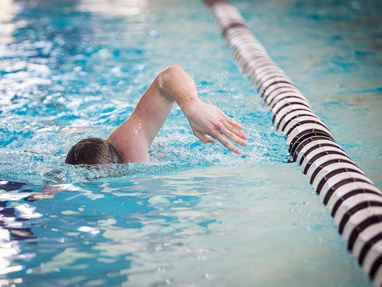 Lukas Bradford swims laps during practice at Central