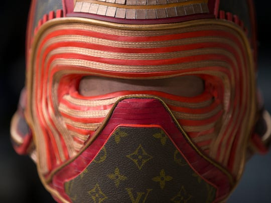 A mask, partially made from Louis Voitton luggage,