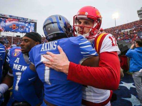 Iowa State Cyclones quarterback Kyle Kempt (17) hugs