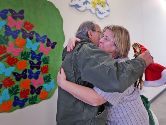 Diane Arnold, right, hugs Russ Heckman at the Hawthorne