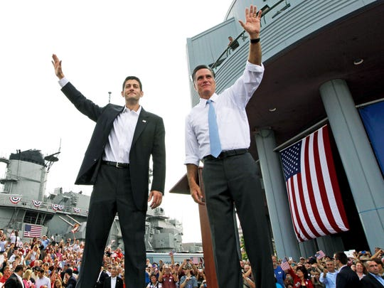 Republican presidential candidate, former Massachusetts Gov. Mitt Romney (right), and vice presidential candidate Wisconsin Rep. Paul Ryan (R-Wis.) wave at the crowd during a campaign event Aug. 11, 2012.