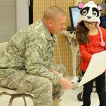 Master Sgt. James Hawke, of the Ohio Army National Guard's 371st Sustainment Brigade, is greeted by students at Garfield Elementary School in Heath. Hawke, who recently returned from Kuwait, was the pen pal of a kindergarten class and a first-grade class.