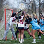 Cape's Margaret Delp and Worcester Prep's Lilly DiNardo battle mid-air for the ball.