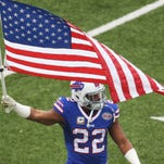 ORCHARD PARK, NY - NOVEMBER 09:  Fred Jackson #22 of the Buffalo Bills leads his team onto the field before the first half at Ralph Wilson Stadium on November 9, 2014 in Orchard Park, New York.  (Photo by Tom Szczerbowski/Getty Images)