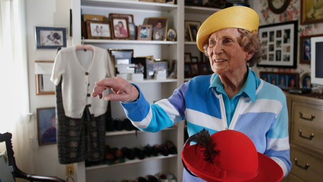 """""""Kinda saucy, huh?"""" Ninety-year-old Alfreda Schmidt, a community activist and former Lansing City Council member says about her yellow hat Monday, May 22, 2017.  Schmidt has a collection of about 100 hats she carefully stores in labeled hat boxes when they're not on her head."""