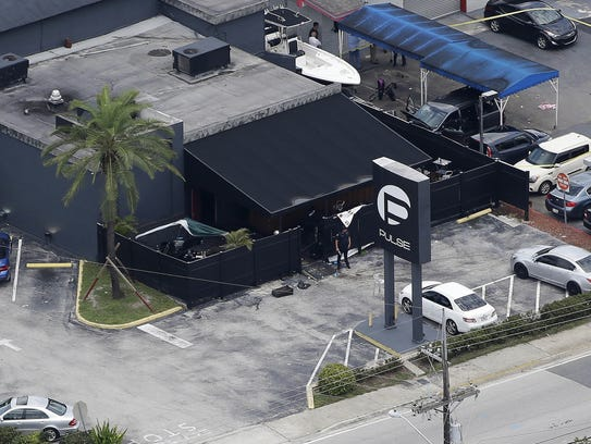 Law enforcement officers work the scene at the Pulse
