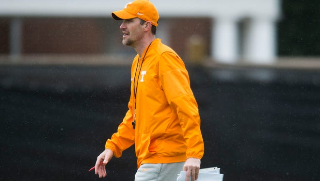Offensive Coordinator and Quarterbacks coach Tyson Helton walks on the field during the first Vol football practice of the spring season at University of Tennessee in Knoxville, Tuesday, March 20, 2018.