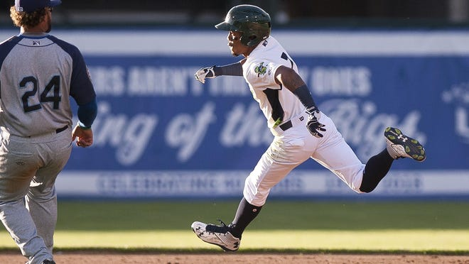 Vermont Lake Monsters left fielder James Terrell, right, rounds second base for a triple against Brooklyn during Wednesday night's game at Centennial Field.