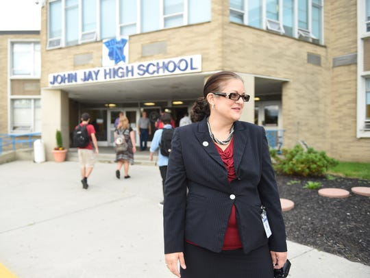John Jay High School Principal Bonnie King watches