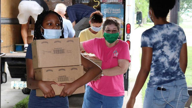 Operation Veggie Box volunteers have helped make the Pamlico County-based food distribution program a success for about 1,000 or more needy families each year in Pamlico, Craven and Beaufort counties.