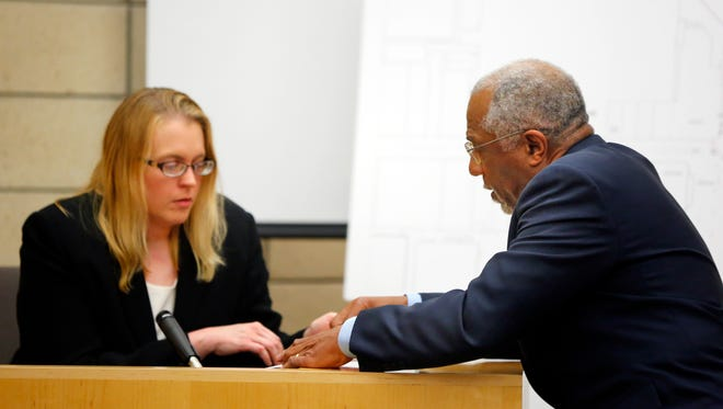Attorney Alfredo Parrish shows Coral Ridge mall security supervisor Wendy Robbins the statement she gave to law enforcement after the shooting as she testifies in the trial of Alexander Kozak at the Story County Courthouse in Nevada on Monday, April 18, 2016.