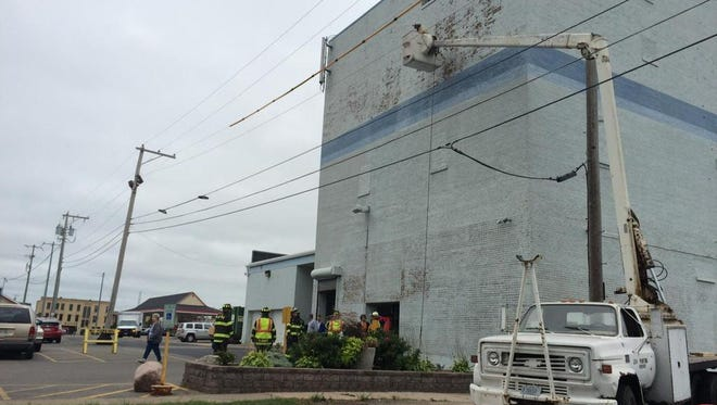 Numerous power lines hampered efforts to rescue a 40-year-old Marshfield man who was stuck aloft in a bucket truck that broke down at St. Vincent de Paul, 169 N. Central Ave., in Marshfield on Tuesday.