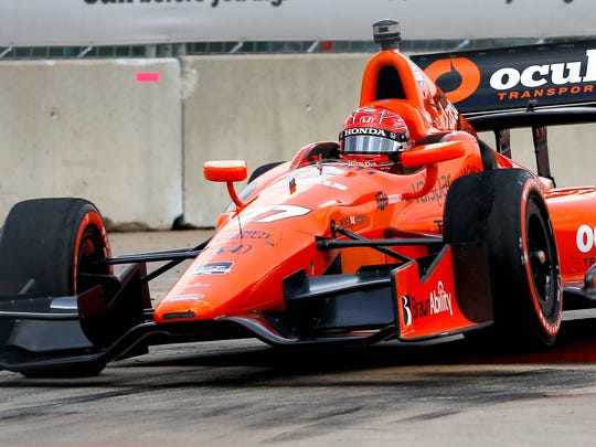 Simon Pagenaud, of France,  drives through Turn 2.