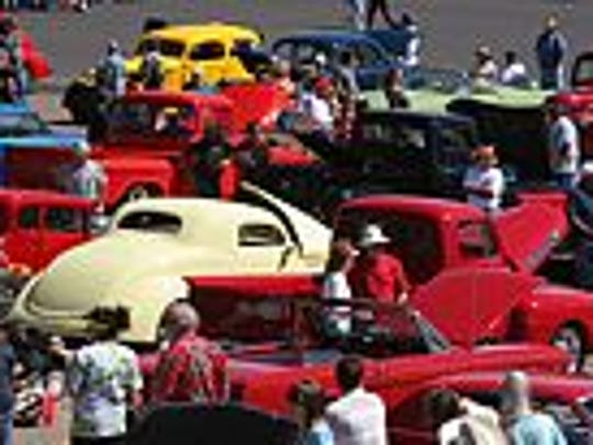 The crowd enjoyed the classics at the car show.