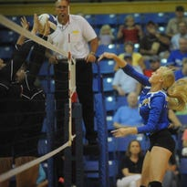 Mountain Home's Kennedy Weiand attempts to hit past a pair of Batesville blockers during a recent match at The Hangar. The Lady Bombers traveled to Harrison on Monday night.