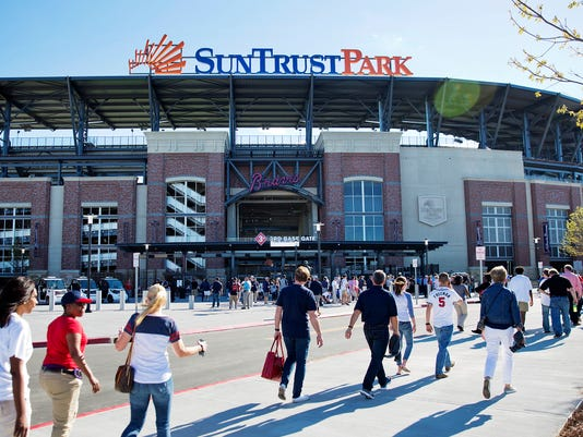 Fans head to SunTrust Park before the Atlanta Braves open their new ballpark in an exhibition spring training baseball game against the New York Yankees in Atlanta, Friday, March 31, 2017. (AP Photo/David Goldman)