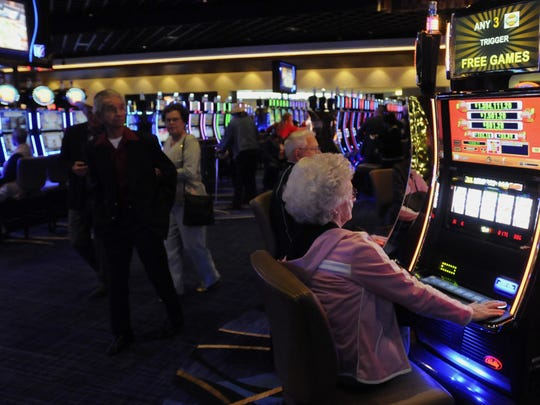 Patrons gamble at Wind Creek Casino, owned by the Poarch Band of Creek Indians, on Nov. 9, 2014. The Poarch Band have talked up a set of gambling proposals for Alabama in the last few weeks.