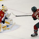 Minnesota Wild left wing Erik Haula (56), of Finland, scores on Florida Panthers goalie Roberto Luongo (1) during the third period of an NHL hockey game in St. Paul on Sunday. The Wild won 3-1.