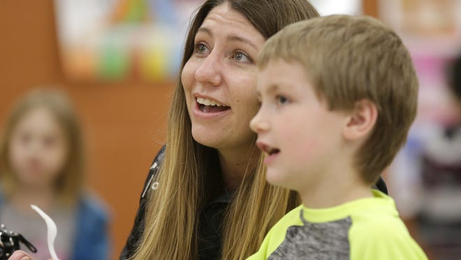 Nicole Roberts and her son, Carter, enjoy a meal Friday at the Boys and Girls Club in Appleton.