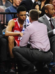 Ohio State Buckeyes guard D'Angelo Russell gets his eye checked out.
